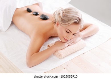 Young, beautiful and healthy girl relaxing in spa salon. Rejuvenation therapy and massaging treatments. Recreation concept.