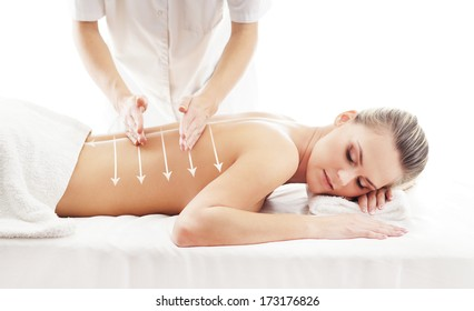 Young, beautiful and healthy woman getting alternative massage treatment (composition with the arrows)