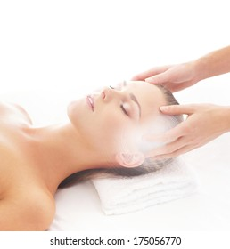 Young, beautiful and healthy woman getting alternative massage treatment (composition with the glares)