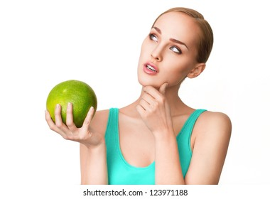 Young beautiful healthy women with ripe green pomelo