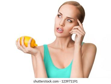 Young beautiful healthy women with ripe lemon
