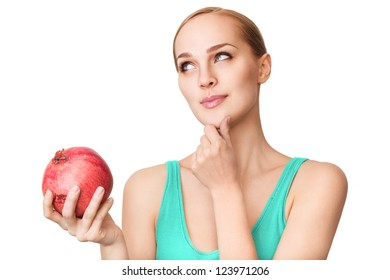 Young beautiful healthy women with ripe pomegranate