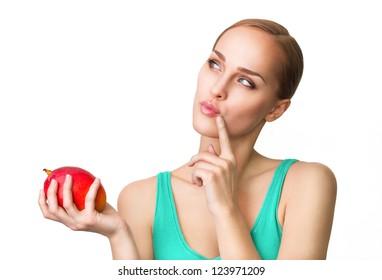 Young beautiful healthy women with ripe mango