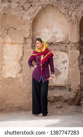 young beautiful iranian lady in an old village in Iran