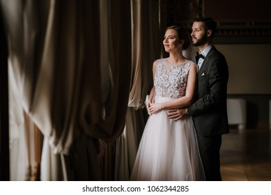 Young beautiful just married couple sharing romantic moments with each other