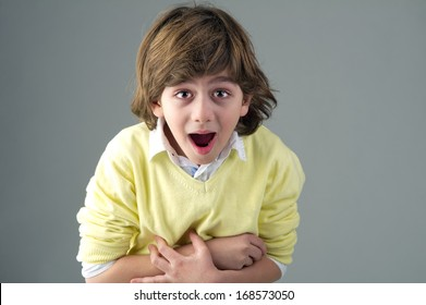 young beautiful kid with shocking painful expression