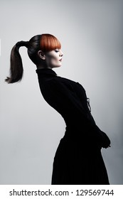 young beautiful lady with with colored hair bowing backwards and posing