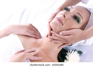 Young beautiful lady getting spa treatment isolated on white