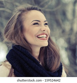 Young beautiful laughing girl in winter - close up