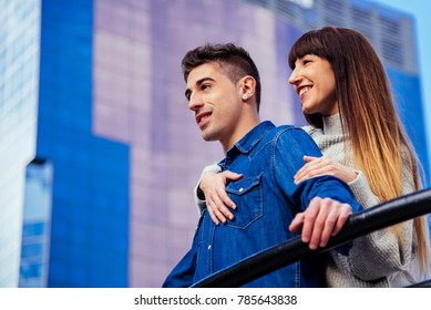 Young beautiful in love couple hugging each other on a romantic way