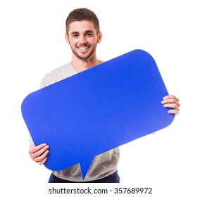Young beautiful man holding a blue bubble for text, isolated on a white background