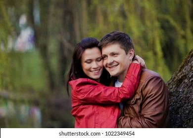 young and beautiful man and woman hugging each other and smiling.