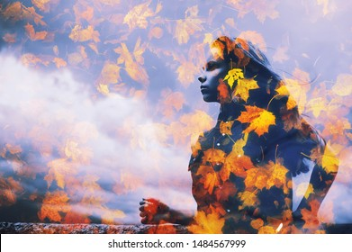 Young beautiful millenial girl in water reflection on falling leaves clouds background. Double or multiple exposure Autumn season, bad weather concept Abstract woman portrait, fall nature environment