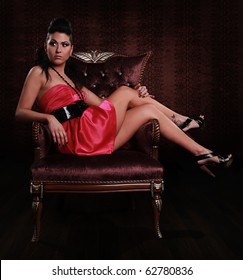 young beautiful model on classic fashionable chair