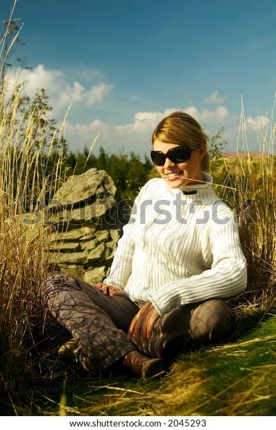 Young beautiful model posing in mountain outdoor scenery