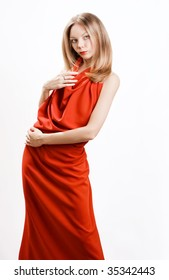 Young beautiful model in a red dress