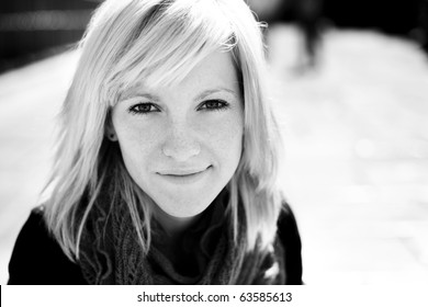Young beautiful monochrome portrait of a blond girl.
