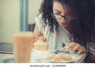 young beautiful moroccan curly woman using tablet at the bar