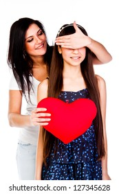 young and beautiful mother gives her daughter a heart