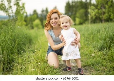 A Young beautiful mother her little toddler daughter