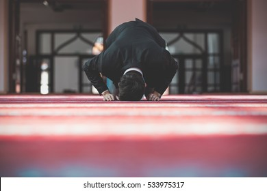 Young beautiful Muslim Man Praying In Mosque