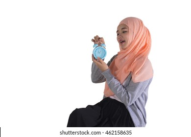 young beautiful muslim woman holding the alarm clock. isolated