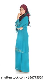 Young and beautiful Muslimah with latest asian fashion over on white background.