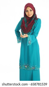 Young beautiful Muslimah possed with nice color choosed dressing up.