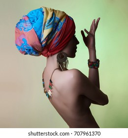 young beautiful naked woman in turban and jewelry accessories. Fashion photo.Beauty lady with colored turban.sexy woman back