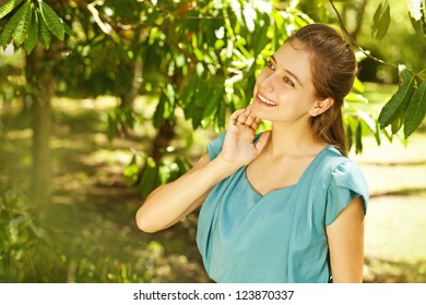 Young beautiful natural woman in the garden (soft focus on eye)