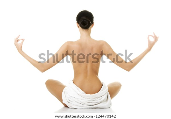 Young beautiful nude woman with towel practicing zoga, isolated on white