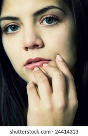 young beautiful pensive woman close up portrait