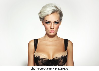 Young beautiful platinum blonde woman with smoky eyes make-up