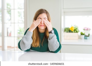 Young beautiful plus size woman wearing casual striped sweater rubbing eyes for fatigue and headache, sleepy and tired expression. Vision problem