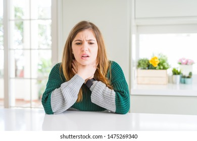 Young beautiful plus size woman wearing casual striped sweater shouting suffocate because painful strangle. Health problem. Asphyxiate and suicide concept.