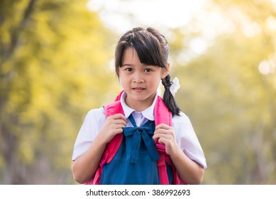 Young of beautiful pre-teen girl with Pink bag. Toned image (Focus on face of the girl)