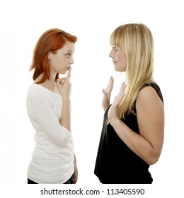 young beautiful red and blond haired girls have to trust her when she told a secret in front of white background