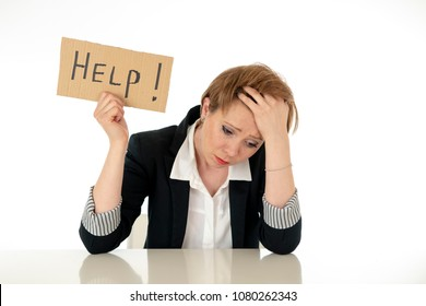 young beautiful red haired caucasian business woman overwhelm and tired holding a help sign. looking Stressed, bored, frustrated, upset and unhappy at work. business frustration concept.