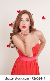young beautiful red head Female blowing kissed to her valentine