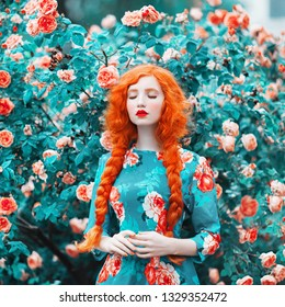 Young beautiful redhead girl with very long hair braided in plait on rose background. Fabulous renaissance woman in flower dress against the backdrop of a beautiful rose bush. Redhead doll with plait