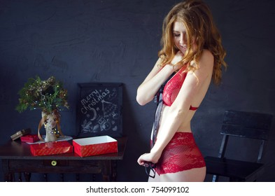dca5163b941 Young beautiful redhead woman woth gift box on her hands. Christmas happy  celebration