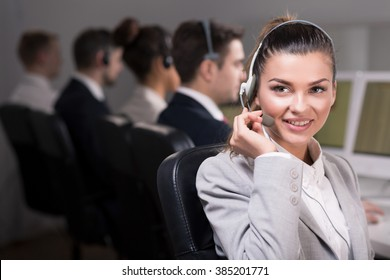Young and  beautiful saleswoman with headset, smiling