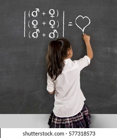young beautiful schoolgirl in uniform holding chalk writing on blackboard standing for freedom of sexuality orientation supporting love for heterosexual and homosexual couples