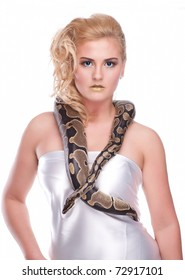 Young, beautiful, sensual woman with snake around her neck; a lot of copyspace available, on white isolated