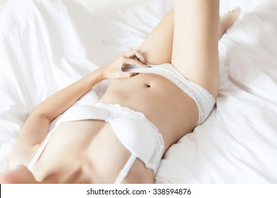 Young beautiful Sexy Asian model wearing elegant lingerie lying on bed