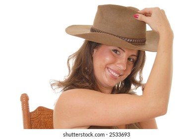 Young beautiful and sexy latina girl wearing cowboy hat
