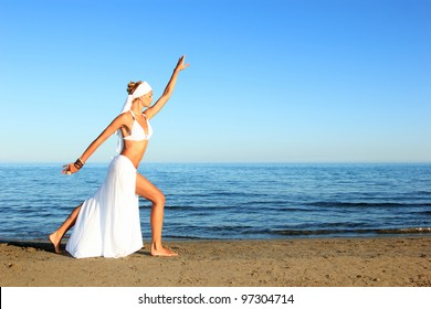 Young beautiful sexy tanned blond woman  on sea beach