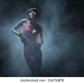 Young, beautiful and sexy woman in fetish dress