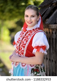 Young beautiful slovak woman in traditional costume on summer