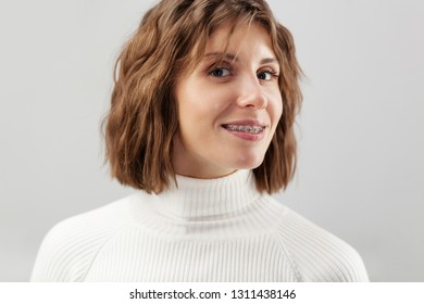 Young beautiful smiley woman with braces
